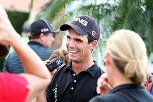Billy Horschel talks on the phone after securing his PGA Tour card during Monday's final round.