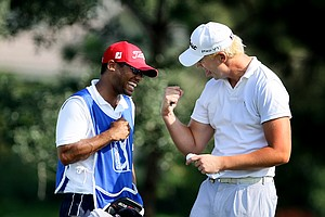 David Lutterus celebrates with his caddie Drake Jones after securing his PGA Tour card.