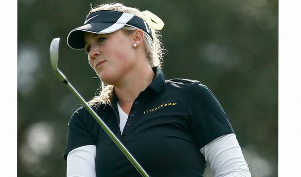 Amanda Blumenherst wins Q-School in a Livestrong polo.