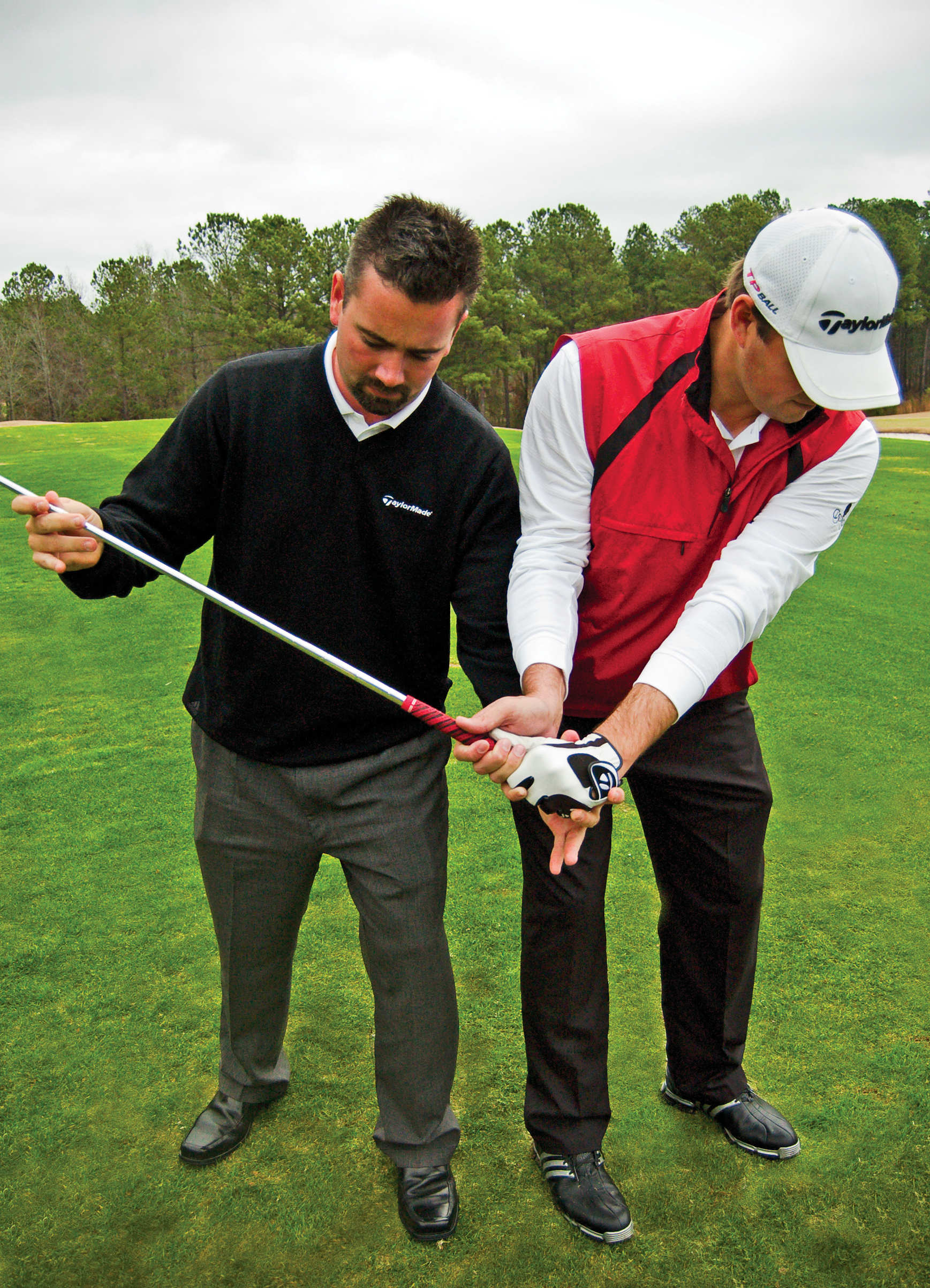 Charles McLendon works with 2010 PGA Tour rookie Blake Adams at Reynolds Plantation.