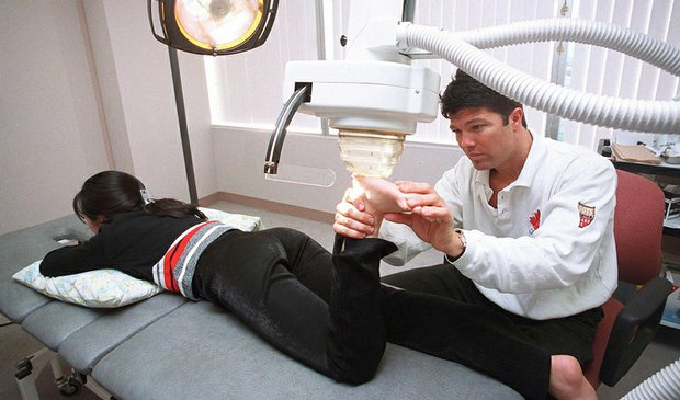 This Dec. 16, 1999, photo shows Dr. Anthony Galea treating a patient with shock wave therapy at the Institute of Sports Medicine in Toronto.