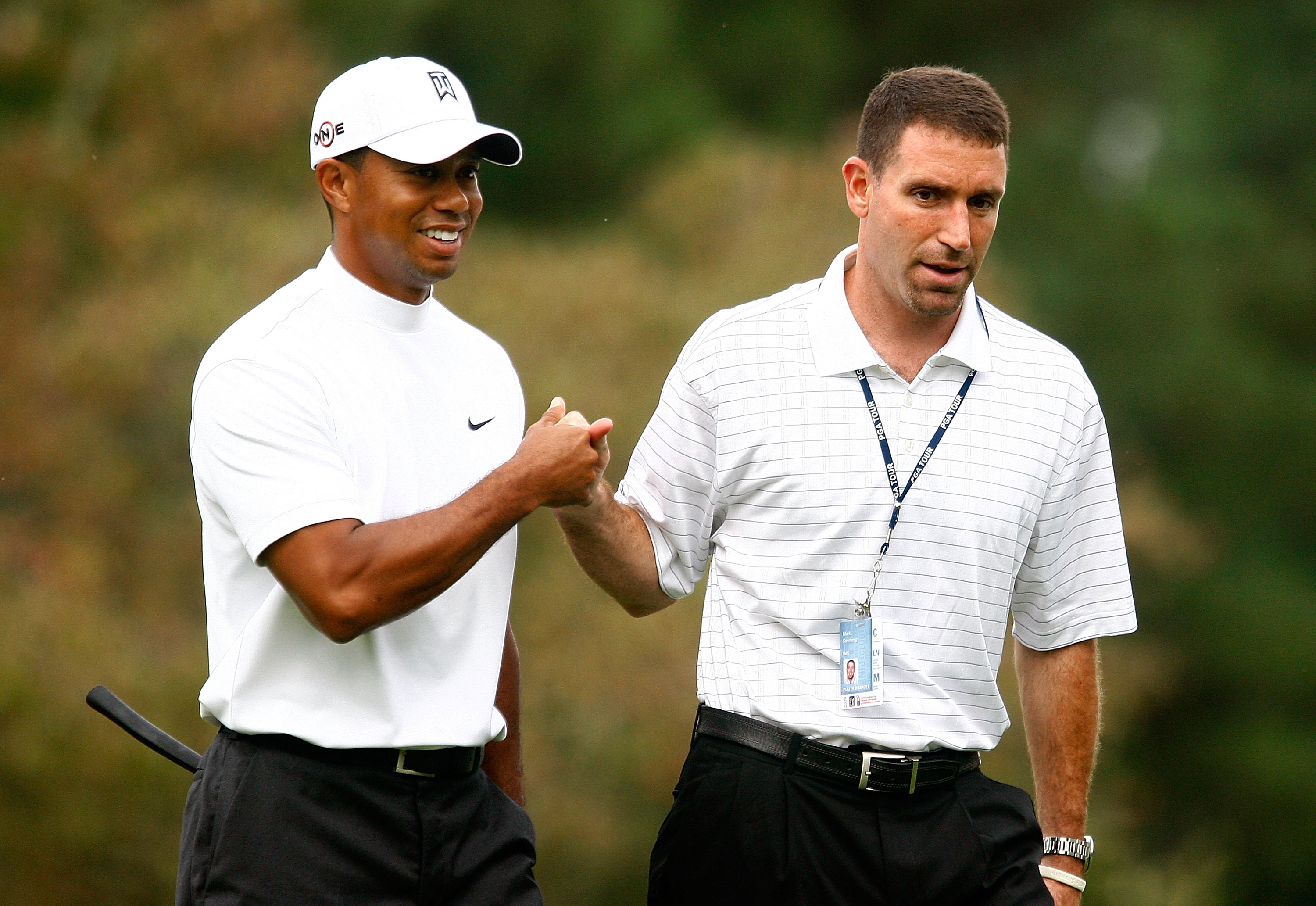 Tiger Woods and his agent Mark Steinberg during a practice round at the Tour Championship.