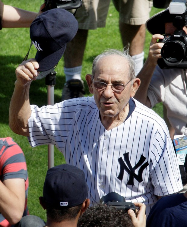 Yogi Berra is introduced to fans before a spring training game on Feb. 26.