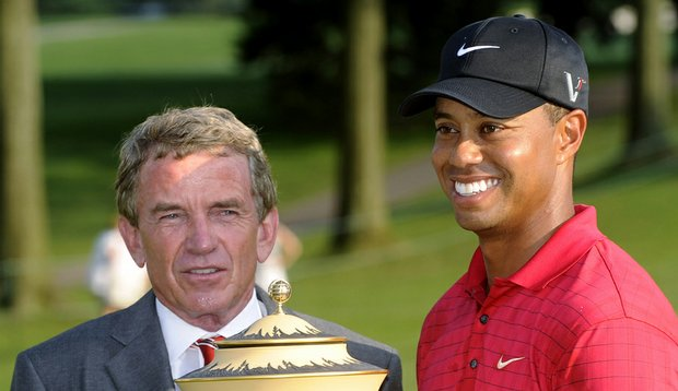 Tiger Woods holds the trophy with PGA Tour commissioner Tim Finchem after winning the Bridgestone Invitational.