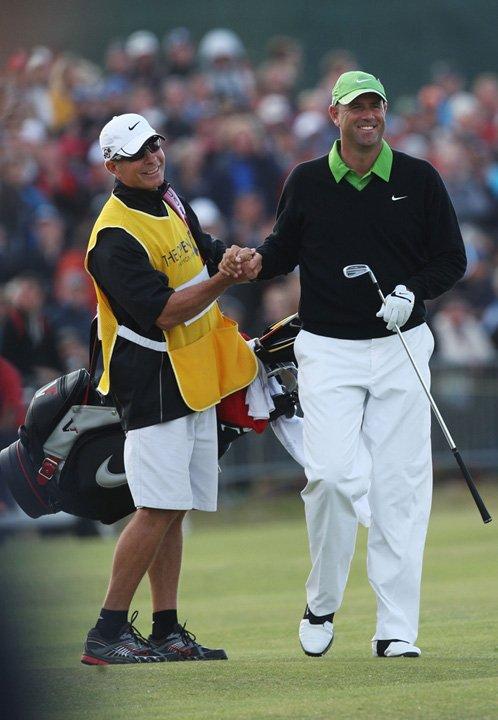 Stewart Cink celebrates winning the British Open with caddie Frank Williams.