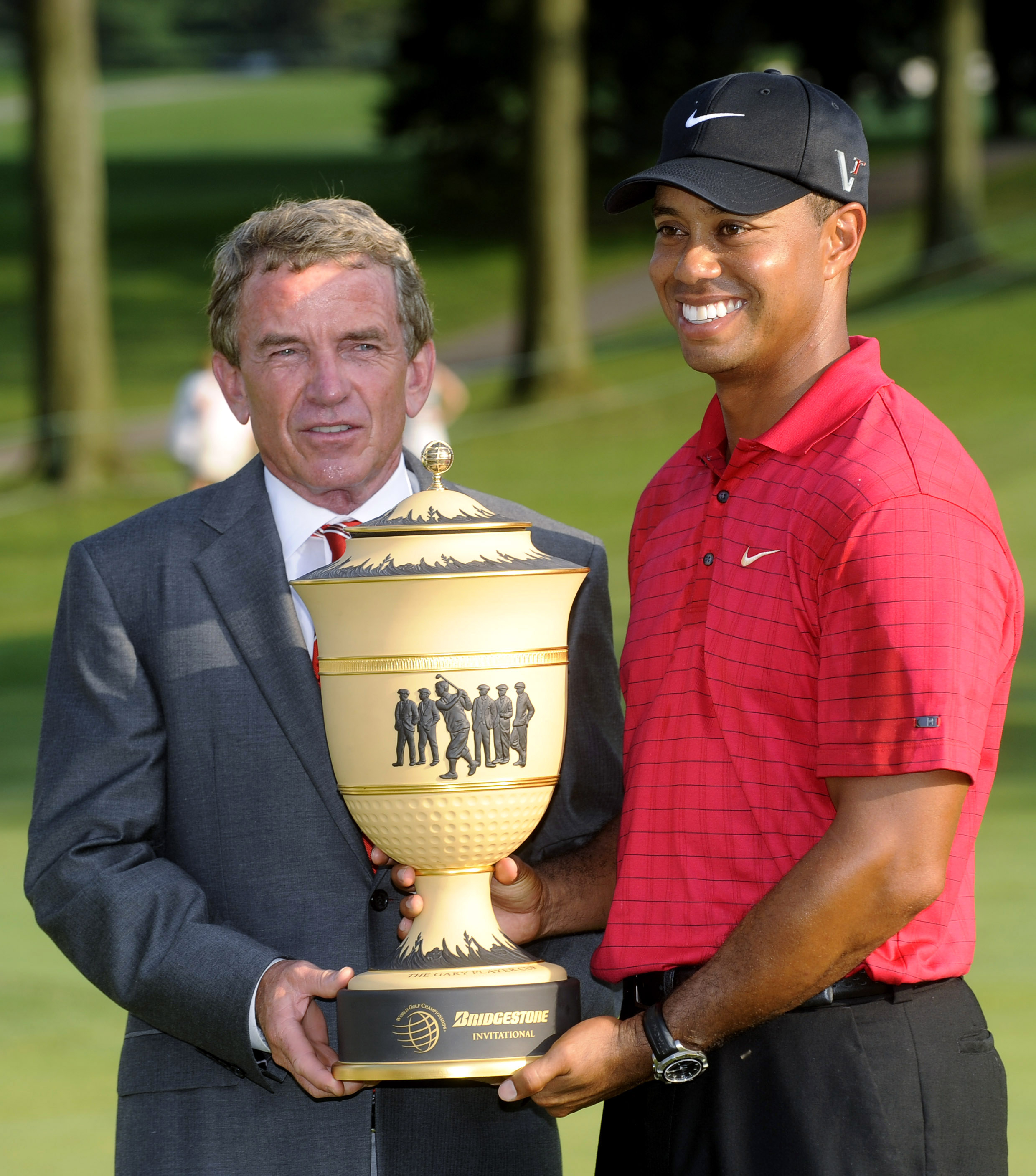 Tiger Woods and Tim Finchem after Woods won the 2009 Bridgestone Invitational.