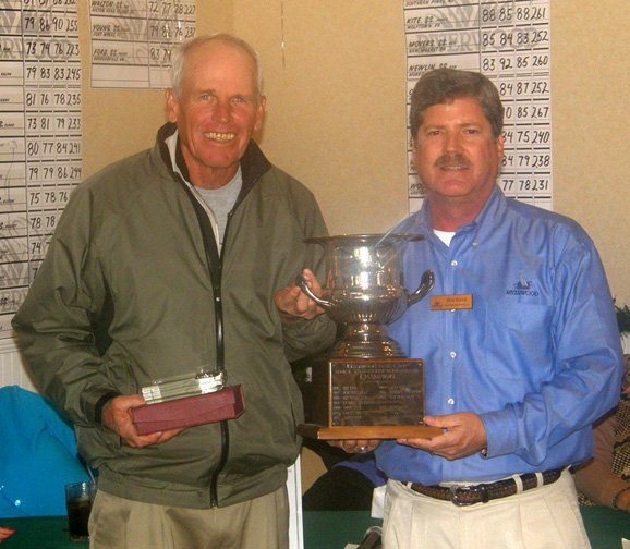 Riverwood's PGA Head Professional Bob Ridge, right, presents the Riverwood Senior Invitational trophy to Bill Zylstra.