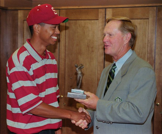 In this June 2, 1996, file photo, Tiger Woods shakes hands with Jack Nicklaus after receiving the Jack Nicklaus College Player of the Year award.