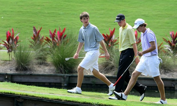 Oliver Schneiderjans (left) walks to the 17th green on the Players Stadium Course at TPC Sawgrass during the Junior Players Championship.