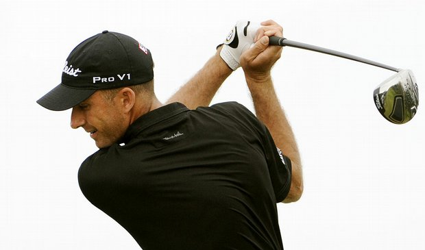 Geoff Ogilvy wins the first event of the 2010 PGA Tour season sporting Travis Mathew apparel.