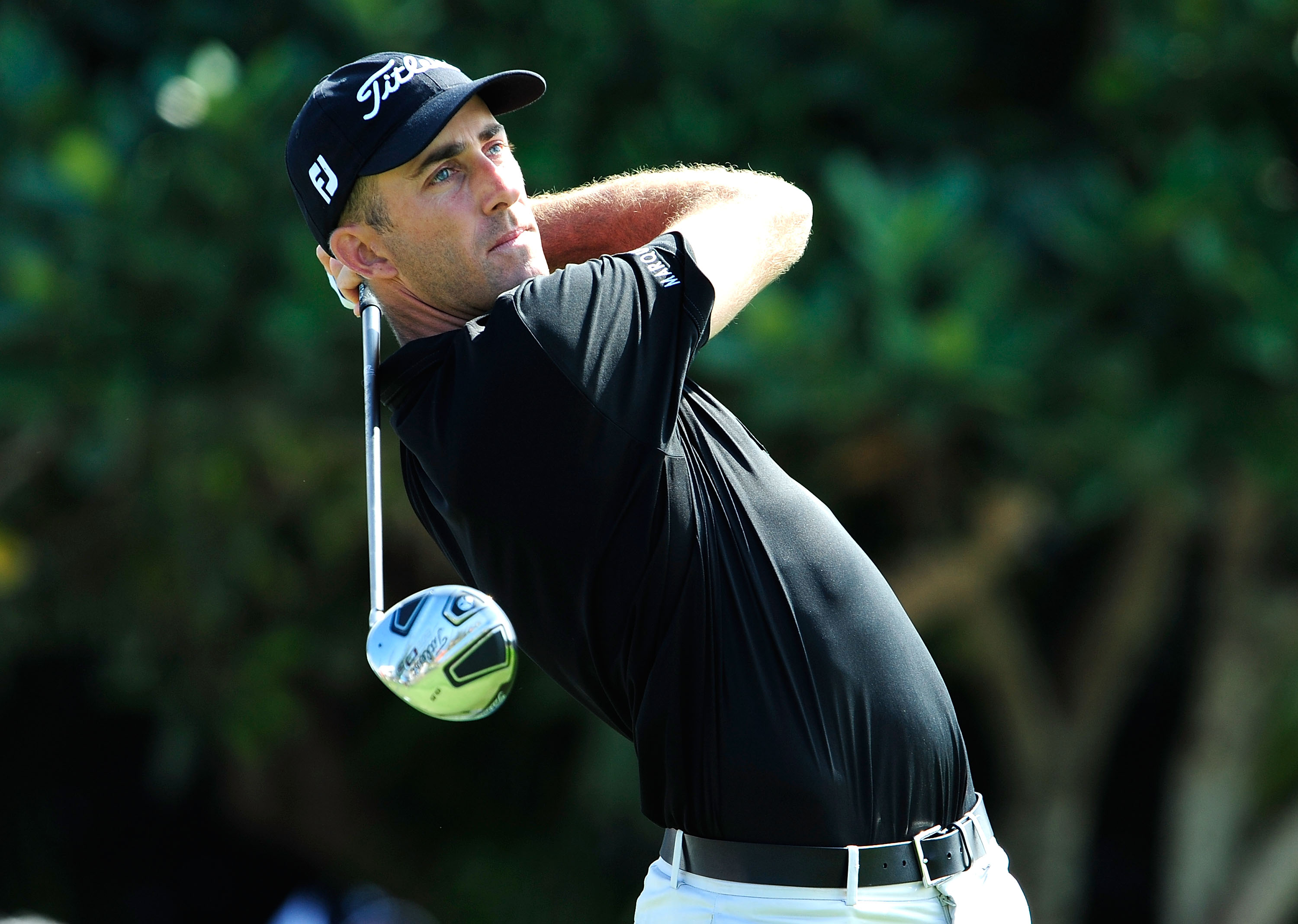 Geoff Ogilvy wins the first PGA Tour event in 2010 wearing Travis Mathew apparel.