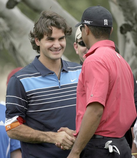 Tiger Woods greets Roger Federer during the fourth round of the 2007 Dubai Desert Classic.