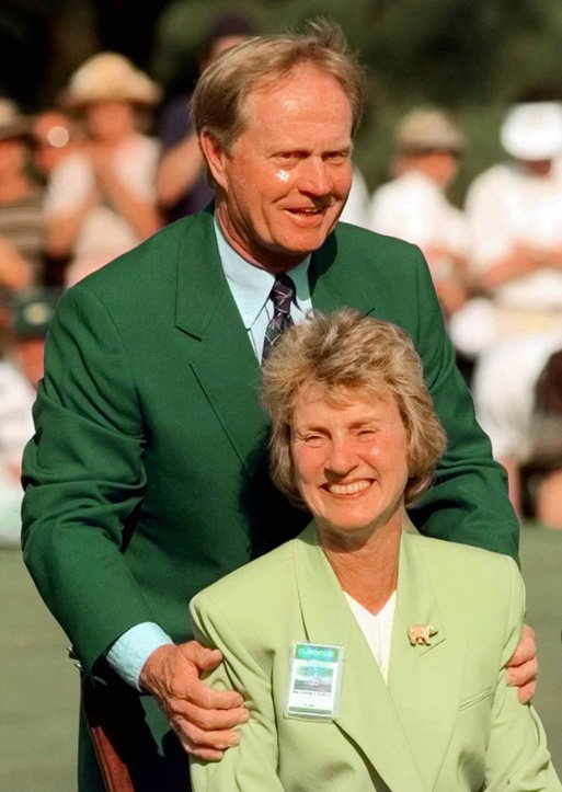 Jack Nicklaus hugs his wife Barbara during a ceremony where a plaque commemorating his six Masters wins was unveiled at the 1998 Masters.