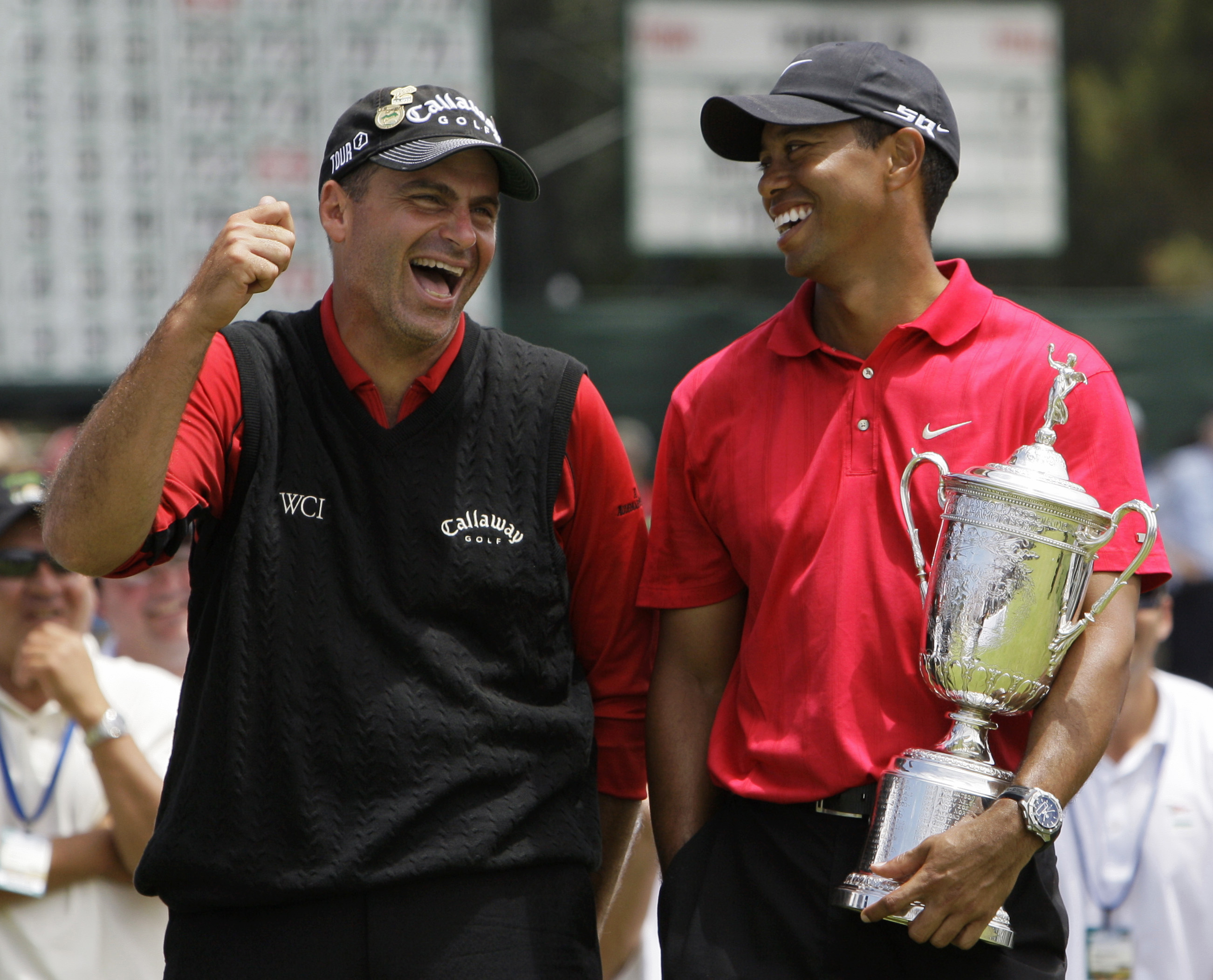 Rocco Mediate jokes with Tiger Woods following Woods' 2008 U.S. Open victory at Torrey Pines.