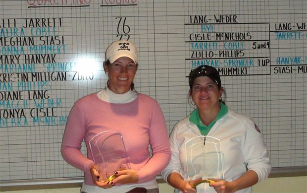Meghan Stasi, left, and Donna Mummert pose with the winners' trophies.
