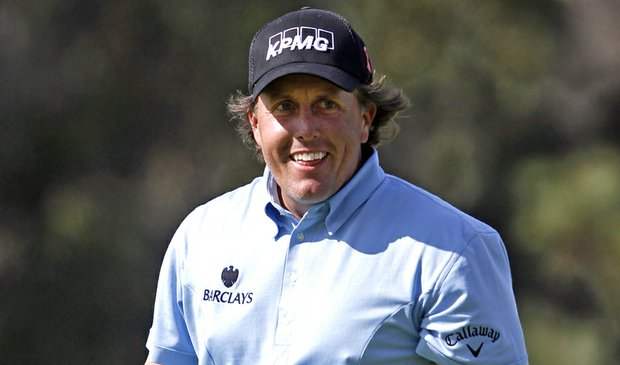 Phil Mickelson reacts after making eagle on the 13th hole.