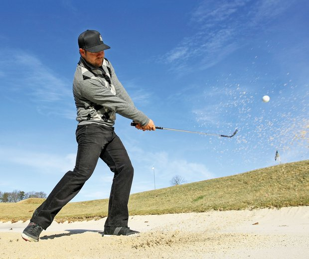 Moore found his own style in bunkers, working to find a style that better resembles his full swing.