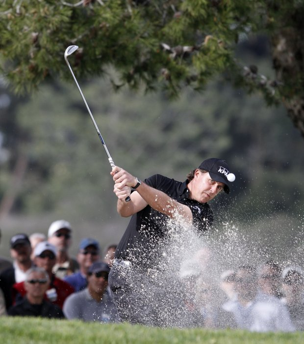 Phil Mickelson hits from a bunker using a Ping-Eye 2 wedge during the second round of the Farmers Insurance Open.