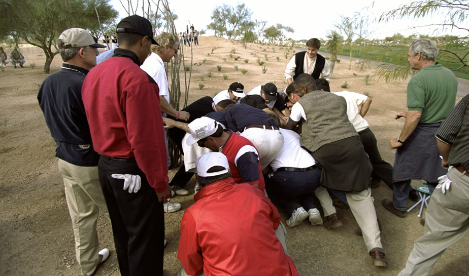 Fans help move a boulder that was in the way of Tiger Woods' ball at the 1999 Phoenix Open.