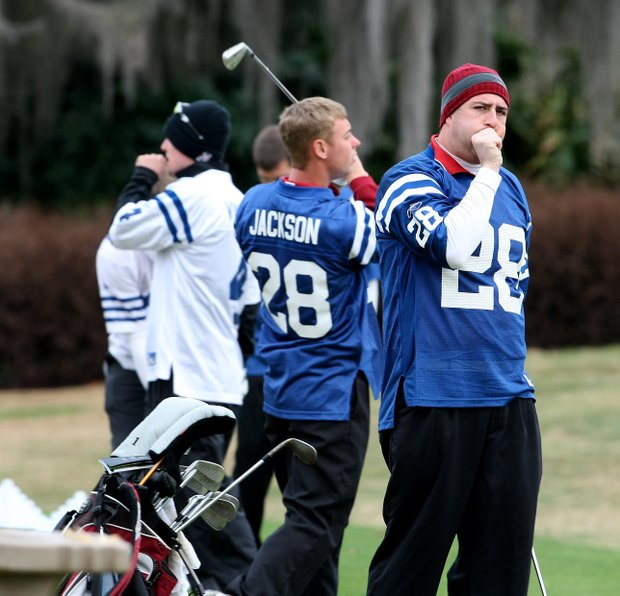 University of Indianapolis' Brad Able tries to keep his hands warm on the range.