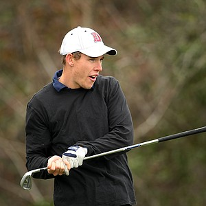 Chad Crowther of Dixie State College reacts to his tee shot at No. 3.