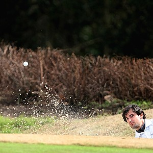 Michael Moore of Nova Southeastern University hits out of a bunker at No. 8.