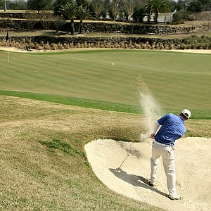 Thomas Muto Jr.of Barton College hits out of the bunker at No. 14.