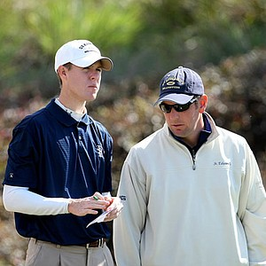Collin Mayer of St. Edward's University talks with his coach, Todd Ohlmeyer, at No. 15 during Round 2 of Golfweek's Spring Invitational at Reunion Resort.