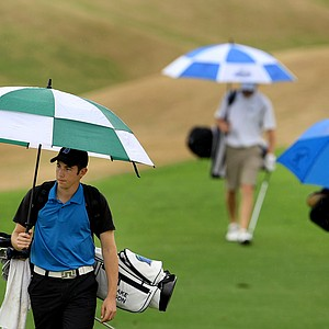 Blake Olson of University of West Florida walks up Hole No. 9 in the rain.