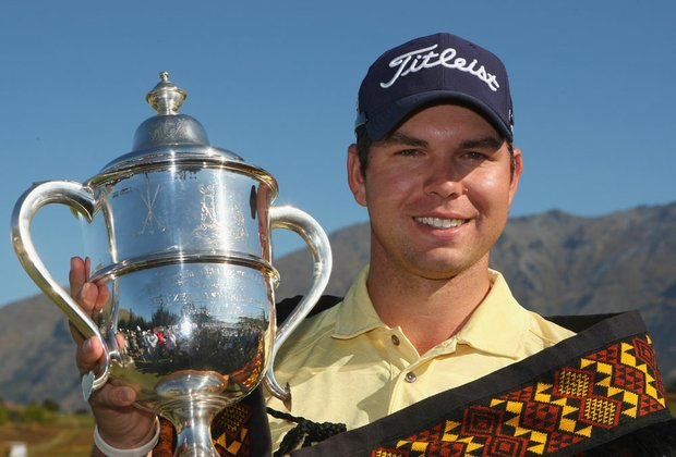 Robert Gates poses with the trophy following his New Zealand Open victory.
