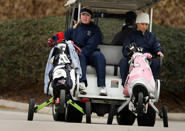 Jessica Korda, left, and Victoria Tanco, right, get a ride to No. 10 after both posted a bogey at No. 9 a par-4.