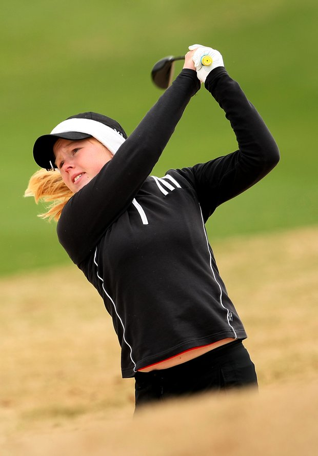 Stephanie Meadow hits out of a bunker at No. 9. Meadow is tied for 17th place after the first round.