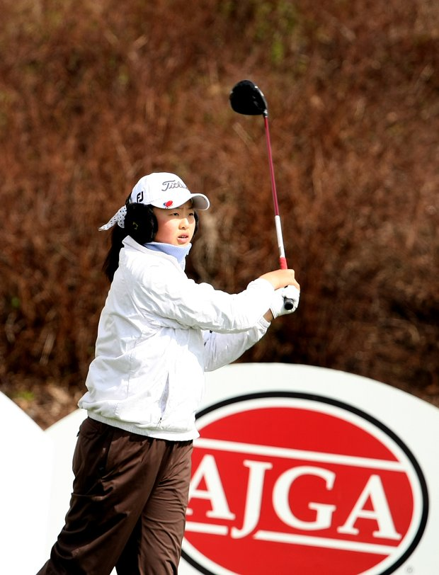 Defending champion, Simin Feng, is tied for 7th after the first round.
