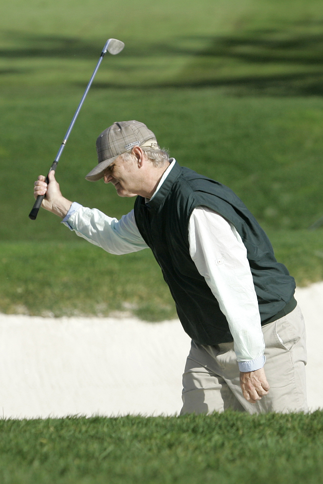 Bill Murray plays out of the sand at the AT&T Pebble Beach National Pro-Am.
