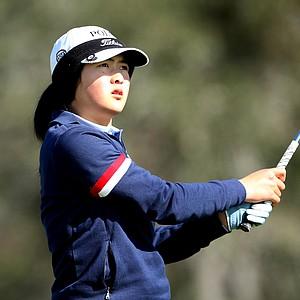 Tiffany Lim watches her tee shot at No. 3.