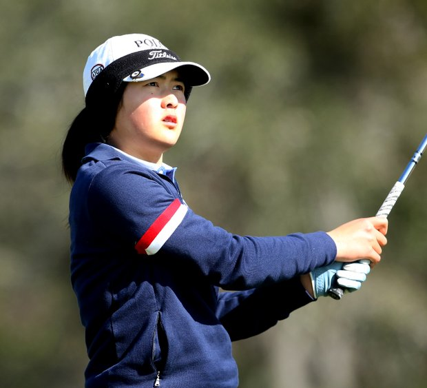 Tiffany Lim watches her tee shot at No. 3.