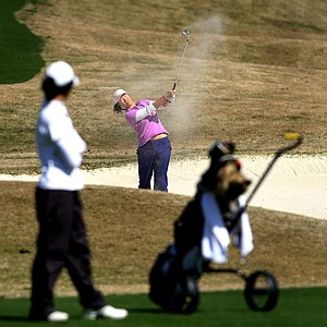 Annie Park blasts out of a bunker at No. 8.