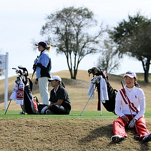 Simin Feng, right, Michelle Piyapattra, center, and A.J. Newell, left, wait to hit their shots at No. 16.