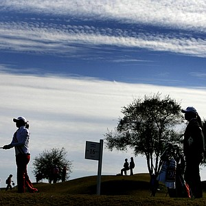 Simin Feng is silhouetted against a cloudy blue sky as she hits her tee shot at No. 16. Temperatures almost reached the 60s during Round 2.