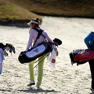 From left to right, Mariah Stackhouse, Kristen Park and Heather Procter, right, make their way through No. 18 fairway.