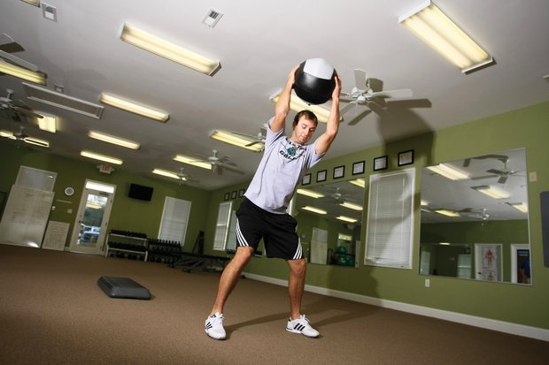 Dustin Johnson works out at Coastal Carolina's golf fitness center, a facility he helped make possible.