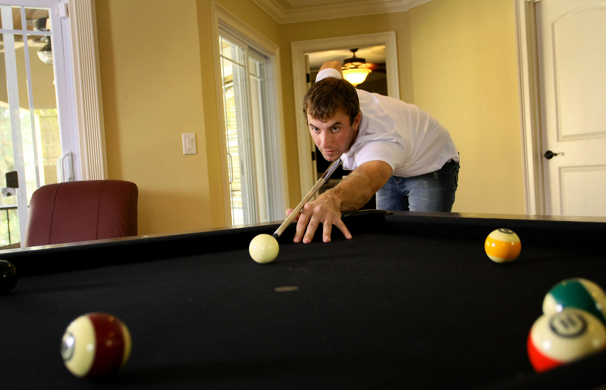 Dustin Johnson shoots pool at his home in Myrtle Beach, S.C.