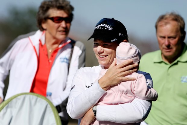 Annika Sorenstam with baby Ava and her parents in tow mingle with the players.