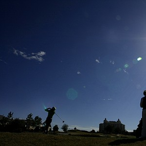 Mariah Stackhouse is silhouetted as she hits her drive at No. 18.