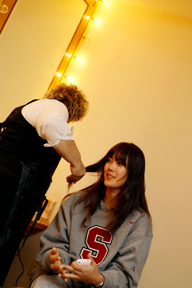 Michelle Wie gets her hair done prior to a Golfweek photo shoot.