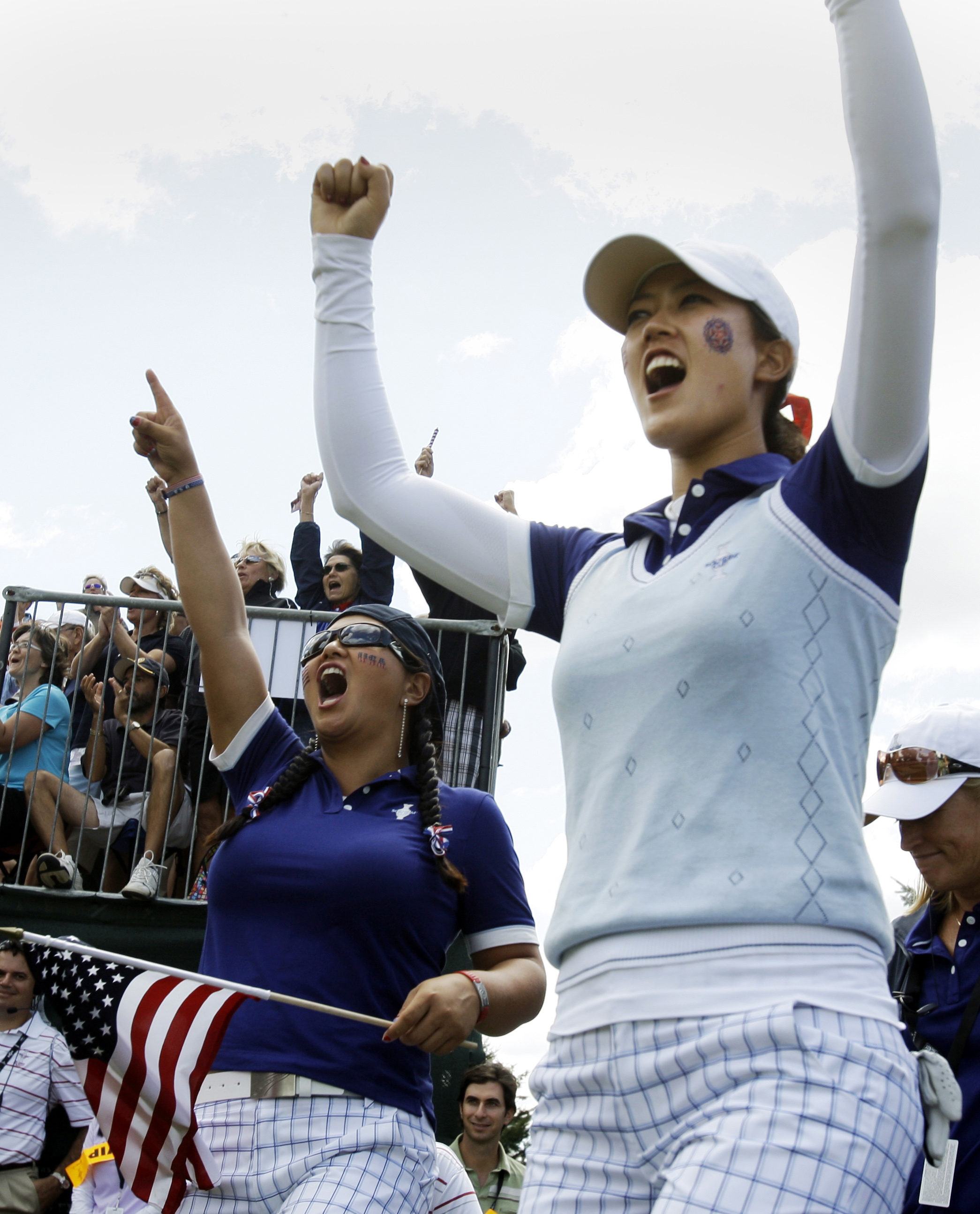 Michelle Wie (right) and Christina Kim celebrate during the 2009 Solheim Cup.