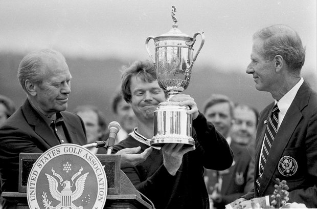 With President Gerald Ford to his right and USGA president Bill Campbell to his left, Tom Watson lifts the U.S. Open trophy.