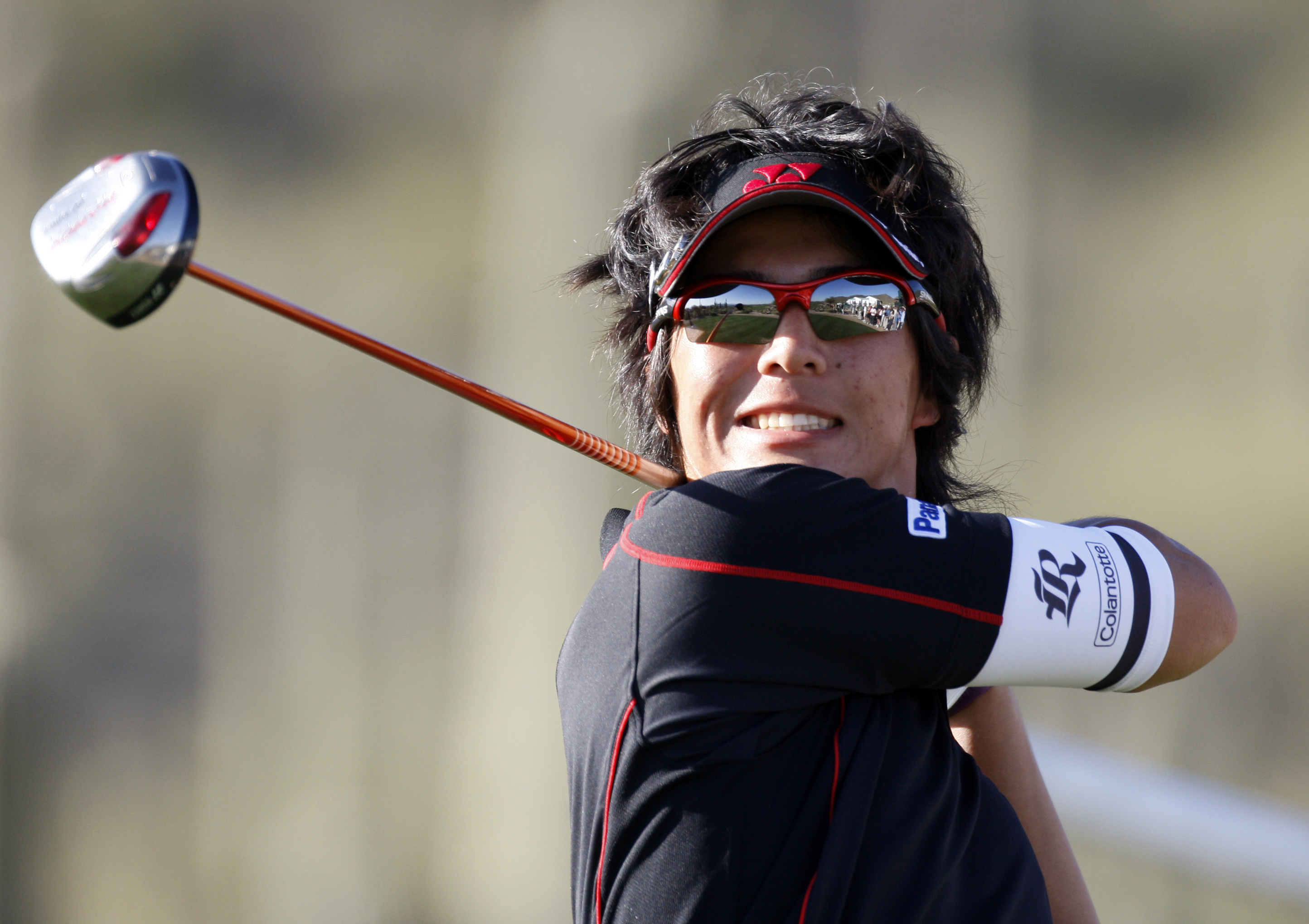 Ryo Ishikawa watches his drive on the 17th hole during the opening round of the Accenture Match Play Championship.