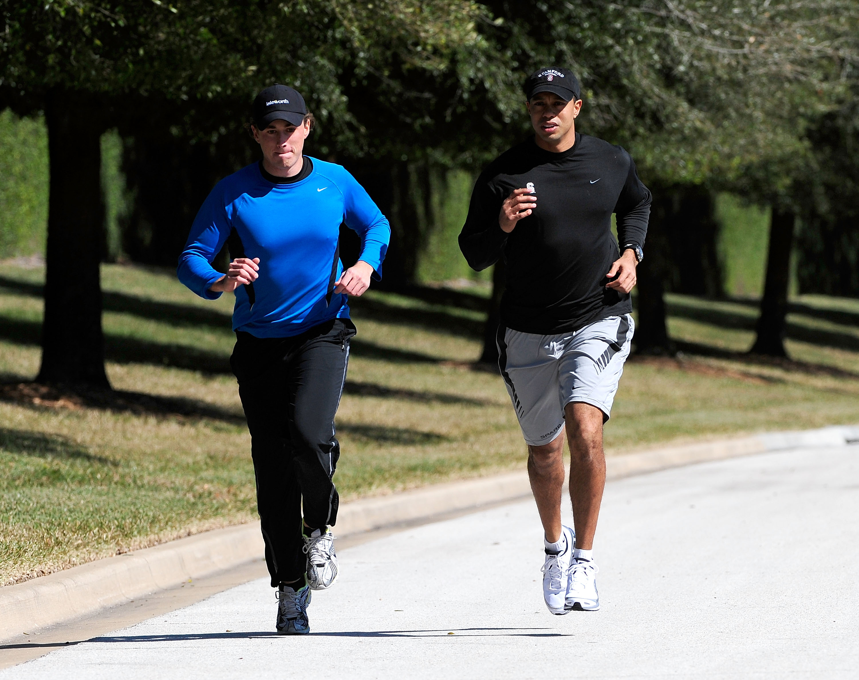 Tiger Woods (right) jogs with an unidentified friend near his Orlando, Fla., home on Feb. 17.