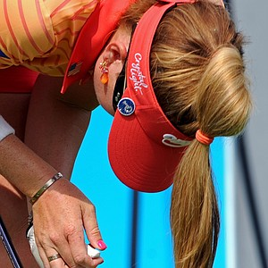 Paula Creamer grabs her injured thumb after hitting a shot at the Honda PTT LPGA Thailand.